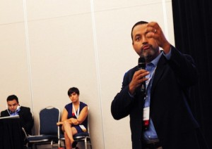 NAHJ President Hugo Balta tells members he's concerned about the current structure of UNITY during the membership meeting on Monday, Aug. 26. (Photo: Robert Dell/Latino Reporter)