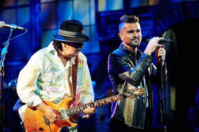 Carlos Santana and Juanes perform at the end of the Univision 2014 upfront.