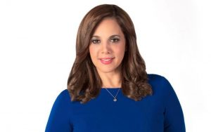 Nilda Rosario anchoring the station's newscasts.